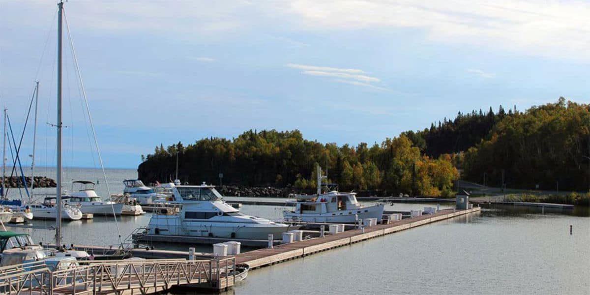 yachts, sailboats and fishing boats at silver bay mn marina