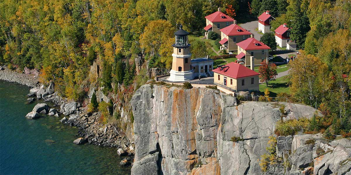 Split rock lighthouse in red roof buildings on Greycliff over Lake superior