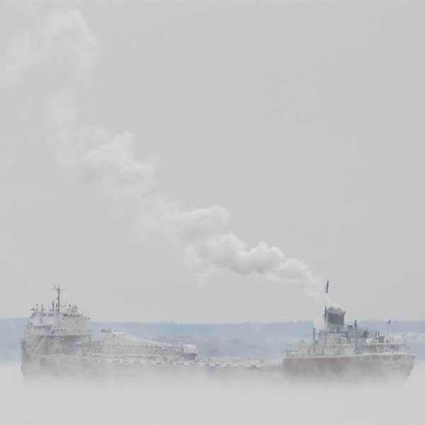 lake superior ship surrounded by sea smoke